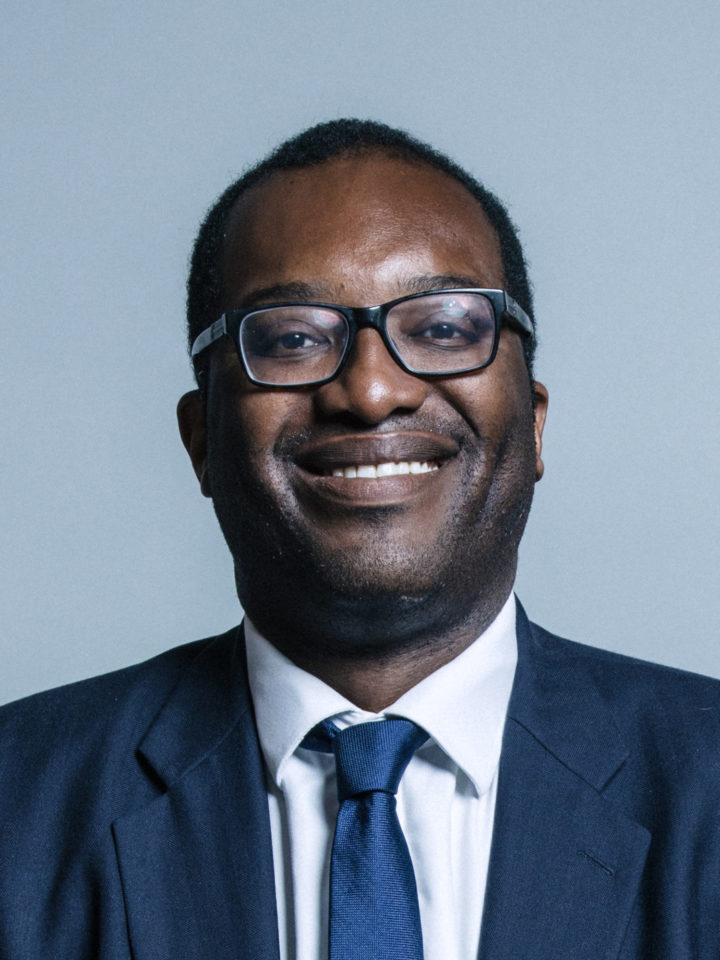Kwasi Kwarteng MP portrait shows Kwasi smiling wearing a suit and blue tie