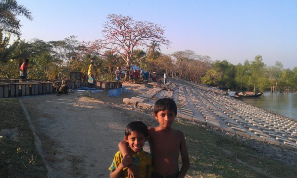 Children on a river bank